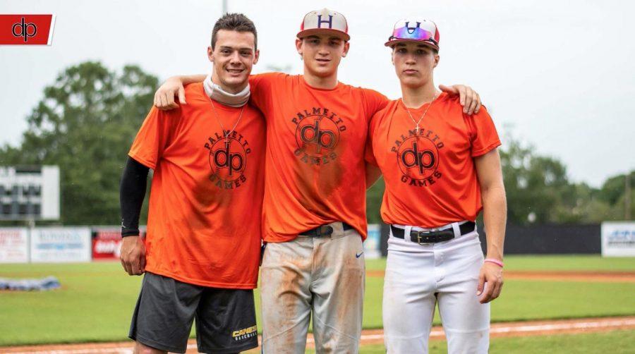 Baseball players Reece Holbrook, Tucker Toman, and Bentley Yeatts.